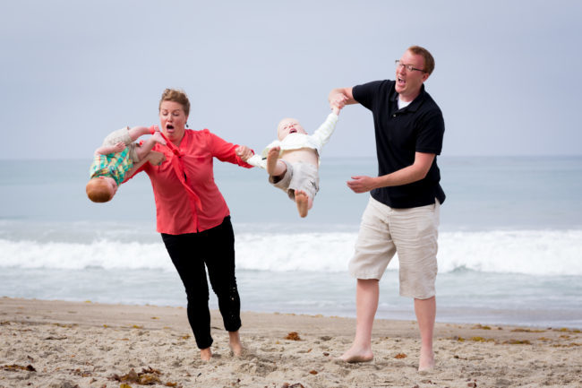 """A mother and father losing control of their children, creating an """"awkward family photo""""."""