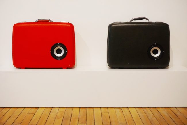 A photo of suitcases inside an exhibit at THEMUSEUM.